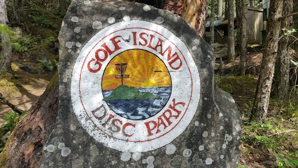 Golf Island Disc Park logo painted on large stone in park